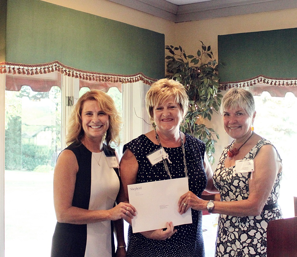 Panhandle Home Health, Inc. Executive Director Lisa Bivens (l) and Director of Development Christina Johnson (m) receive the WISH nonprofit grant from Grants Committee Vice-Chair Carol Kable (r)